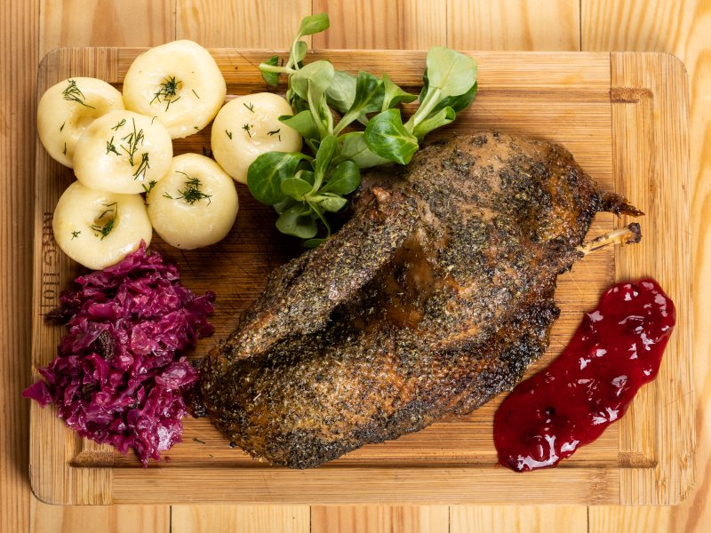 Half of duck roasted in marjoram